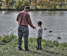 Grandpa and Grandson..feeding the ducks    :)