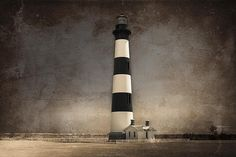 The Keeper of the Graveyard - The beautiful Bodie Island Lighthouse on the Outer Banks North Carolina.