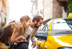 Stock Photo : Young elegant couple taking taxi on the street