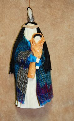 """Today I made this cute Native American corn husk doll and her baby. She is 6 1/2"""" tall. I am making a lot of other corn husk dolls and will put them on my tree next Christmas."""