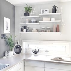 Shades of gray in white, modern kitchen, String shelves | Kitchen by Monique Therese via http://instagram.com/moniithe/