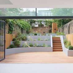 Use clever design to transform an awkward space into an ideal outdoor area. Here's some advice from Real Homes' garden expert Matt James on how to make the most of a sloping garden. Steep Backyard, Sloped Backyard Landscaping, Backyard Retaining Walls, Sloped Garden, Backyard Patio Designs, Terraced Patio Ideas, Steep Gardens, Back Garden Design, Contemporary Garden