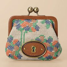 Such a lovely coin-purse!  The floral stitching and soothing colors work hand-in-hand to sweeten a lady's appearance.