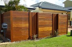 attractive wood front fence  Dark Wood Fencing  Wood and synthetic wood fencing is attractive, chic, and modern. Skip the paint, opt for a bare or varnished wood to let the natural patterns shine.