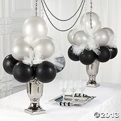 Paint hurricane glasses with gold paint or black glitter.  Use black and pink balloons.  Gold toole
