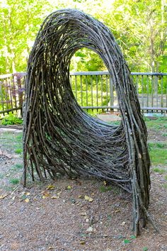 Window arch  by Kelly Brown  and  Bower Bird Sculpture