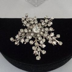 Art Deco Floral Layered Rhinestone Brooch Set in Silvertone Metal and made in the 1930's. We are offering free shipping to the United States. www.CCCsVintageJewelry.com