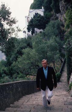 Title:Gore Vidal   Caption:August 1984: Writer Gore Vidal climbing hillside steps at Ravello in Italy.       Artist:Slim Aarons  Date:1984