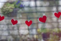 DIY Sewn Heart Garland. I can buy a heart hole punch and use the paper from the old books I have.