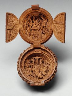 Intricately carved rosary bead, early 16th century Brabant, boxwood    Cloisters collection of the Metropolitan Museum of Art