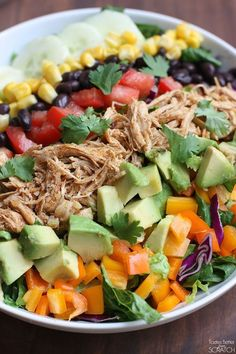Shredded Chicken Taco Salad - Super easy and flavorful slow cooker chicken with fresh veggies! Chipotle Ranch Crema Dressing Recipe Included! YUM!