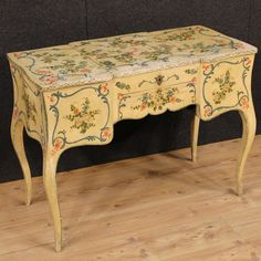 """Price: 2300€  French dressing table of the late 19th century. Furniture in lacquered and painted wood with floral and animal decorations. Dressing table equipped with an external drawer and pull-out writing surface. Top hiding three internal compartments covered with blue fabric, side compartments equipped with two large """"secrets"""" compartments with wooden jars. Dressing table finished from the center. #antiques #parino Visit our website www.parino.it"""