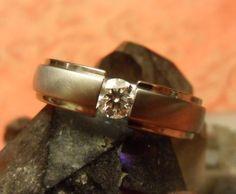 Its a .38ct I VS2 Brian Gavin Diamonds H set in a Bruce Boone Titanium ring, size 8.75.