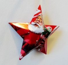 Santa Coke Star Holiday 2014 Collectible, Christmas Ornaments Soda Can Upcycled Coca Cola by LizardSkins on Etsy https://www.etsy.com/listing/211986266/santa-coke-star-holiday-2014-collectible