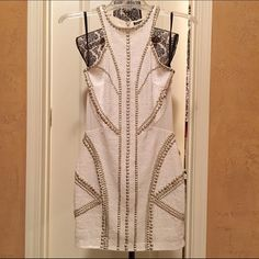 Bebe Dress - White Sequenced White with Silver Sequenved dress. Beautiful! Elegant & great for a special event or party! Used once. In good condition. Size XS. Stretches. & is nylon & spandex. Dress is about 28 inches long. No trades but offers are welcome! bebe Dresses Mini