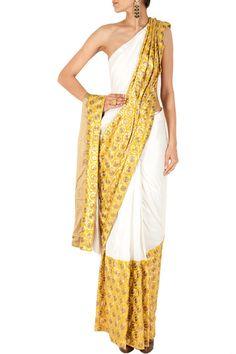 White and yellow embroidered sari BY NIKHIL THAMPI. Shop now at perniaspopupshop.com #perniaspopupshop #clothes #womensfashion #love #indiandesigner #NIKHILTHAMPI #happyshopping #sexy #chic #fabulous #PerniasPopUpShop