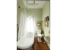 Two Tone Bathroom Wall And Hanging Oval Shower Curtain And Rod