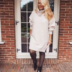 Sweater dress, patterned tights and leather booties   For more style inspiration visit 40plusstyle.com