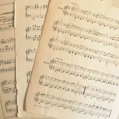I'd use sheets of vintage sheet music as a cover