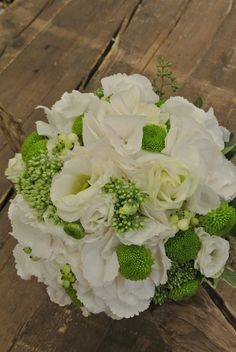 Bridal bouquet with lisianthus,hydrangea,spray mum,sedum,snowberries,seeded eucalyptus
