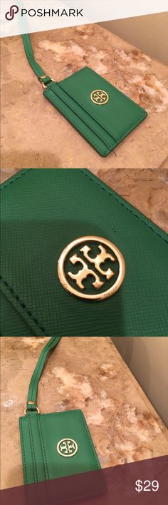 Authentic Tory Burch Credit Card Holder Bright green leather five pocket credit card holder with leather carrying strap and gold Tory Burch logo. Perfect if you just want to take a few credit cards, license, etc and not bring your whole big handbag or wallet. Tory Burch Accessories Key & Card Holders