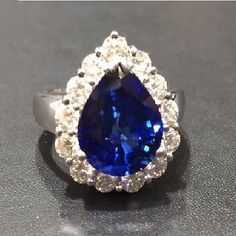 Beautiful 5.82 Carat Royal Blue Sapphire and Diamond Ring made in 18k White Gold