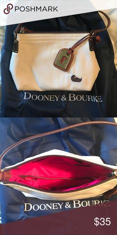 Dooney and Bourke White Nylon Purse Perfect condition!!! Real Dooney - does not come with dust bag! Pink interior with key line. Pockets inside. Perfect small purse Dooney & Bourke Bags Mini Bags