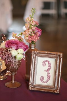 Gold spray paint + thrift store frames/glassware + fresh flowers = beautiful centerpieces and table numbers
