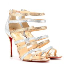 Christian Louboutin - Mariniere Glitter Mini 100 glittered-leather sandals  - Put your best foot forward this party season in Christian Louboutin's glittered-leather sandals. The multi-strap front encases the foot for a flattering finish. Zip them on with a fluted skirt - the towering heel will make your legs go on forever.  seen @ www.mytheresa.com
