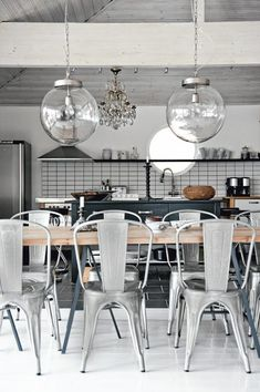 love the wooden table with the industrial tolix chairs