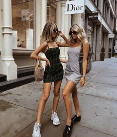 striped spaghetti strap mini dresses with sneakers and slip-on black shoes. Visit Daily Dress Me at dailydressme.com for more inspiration women's fashion 2018, street style, NY street style, sneakers, slip-on shoes, mini dresses, summer outfits