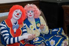 """Christian clowns    Deano and Daisy clap along with the New Hope Baptist Church choir from Fayetteville, Georgia, as they present """"Who Do You Say I Am?"""" in Pontypridd, Wales."""