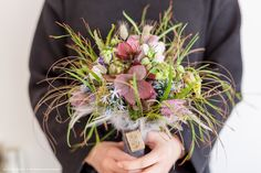 Bridal bouquet with feathers at the Zita Elze Design Academy by Yo Eun Saem - Advanced Wedding Design - floristry school, Kew, London Photo: Julian Winslow  1875_wm