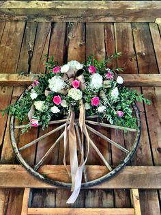 Decorated wagon wheel Dark Teal Weddings, Wagon Wheel Decor, Wagon For Wedding, Western Wreaths, Purple Lily, Wagon Wheels, Wedding Stuff, Wedding Ideas, Country Barn Weddings