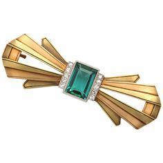 Mixed Metal Tourmaline  Diamond Bow Pin. 18kt Yellow , Rose Gold  Platinum Pin set with a Flawless Green Tourmaline edged with a single row of Diamonds on either side. Beautifully constructed  created. Ca. 1930-1940