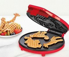 Make breakfast fun for the kids with Circus Shapes Waffle Maker. With an elephant, monkey, and giraffe you are sure to make breakfast a blast.