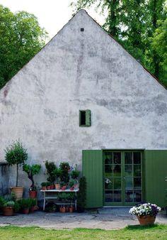 Green doors and raw walls