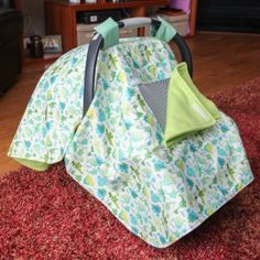A car seat canopy is perfect for protecting a sleeping baby from cold, wind, rain, or snow when moving between the house and the car!