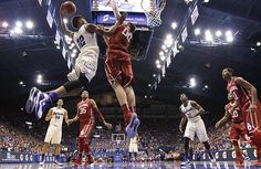 Kansas guard Kelly Oubre Jr. (12) pulls back for an attempted dunk as he attacks the basket against Oklahoma forward Ryan Spangler (00) during the second half on Monday, Jan. 19, 2015 at Allen Fieldhouse.