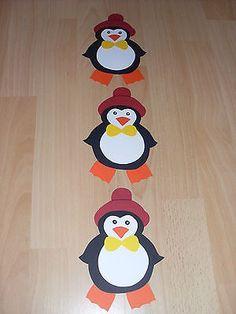 Fensterbild -Kette Deko Tonkarton basteln Winter Weihnachten Pinguine Schleife