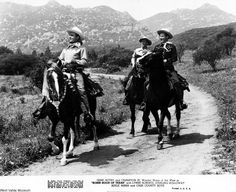 """Gene Autry and Champion Jr. starring in """"Robin Hood of Texas"""" with Lynne Roberts, Sterling Holloway, Adele Mara, and Cass County Boys, 1947. The movie was filmed in Chatsworth at Chatsworth Lake.  West Valley Museum. San Fernando Valley History Digital Library."""
