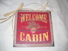 "Welcome to Our Cabin Lodge Decor Wooden Wall Art Sign by The Little Store Of Home Decor. Save 20 Off!. $7.99. made in the USA. size 7x7. We've sealed this Welcome to Our Cabin print onto wood giving it a framed appearance. The background color is a creamy tan color with touches of brown and black to accent the print. It measures approximately 7"" squared by 1/4"" thick (wood dimensions not including hanger). We've added a rusty tin wire hanger accented with a raffia ribbon bow for easy hang..."