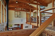 A bridge that doubles as a Library passes through the two story living room and connects two bedroom wings.Capturing daylight was a priority, a flip up dormer helps catch more sunlight from the south.