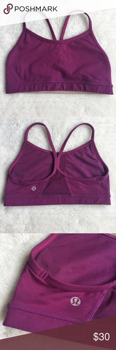 """Lululemon Purple Sports Bra size 4 Preowned authentic Lululemon Purple Sports Bra size 4. Armpit to armpit is 12"""" inches. No pads. Please look at pictures for better reference. Happy shopping! lululemon athletica Tops"""