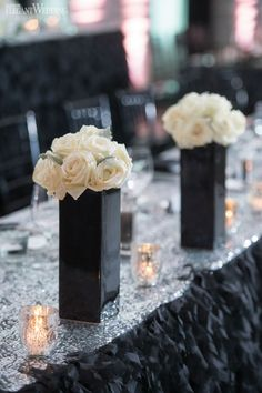 Wedding ideas for a Black & White Themed wedding Toronto wedding planner Fab Fête Event Planning Boutique brought bride Alyssas vision of luxury to life with glamorous sexy and Fancy decor forher wedding to high school sweetheart Vincent. Black and white were the primary colours used a combination of high and low centrepieces with white