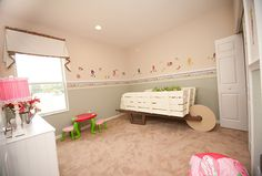 Strawberry Shortcake and her friends would be right at home in this sweet girl's room. Highland Homes' Williamson II model home in Plant City, FL. Wheelbarrow bed custom made by Constant Creation of Lakeland, FL. Bedroom Themes, Kids Bedroom, Creative Kids Rooms, Highland Homes, Bedroom Pictures, New House Plans, Florida Home, Model Homes, Home Builders