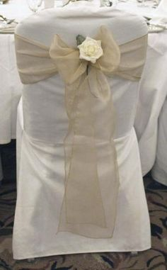 Wedding chair covers with cystal organza sash hire Pretty Chairs Very effective. Wedding Reception Chairs, Wedding Chair Sashes, Wedding Chair Decorations, Wedding Fabric, Chair Cover Hire, Chair Covers, Greek Wedding, Our Wedding, Wedding Ideas