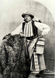 Quanah Parker, Quahahda Comanche chief, shown with buffalo robe circa 1867-1874. Center for American History, U.T.-Austin, (CN01356). Texas Beyond History.