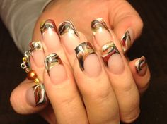Black, white, gold and bronze nail art marble with a dangler
