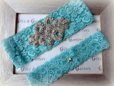 Wedding Garter Set - TURQUOISE Lace SILVER Rhinestone Crest Show & Dual Stud Toss - other colors available. $19.95, via Etsy.